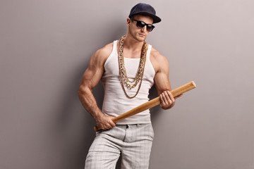 Muscular gangster holding a baseball bat