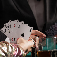 Aces and kings in womans hands