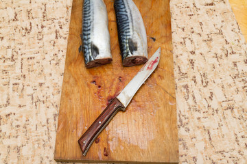 mackerel without head on a wooden Board
