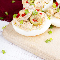 stuffed eggs with tuna, olives and paprica