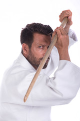 aikido master with wood sword in defensive position