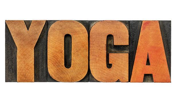 yoga word in wood type