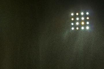 Papiers peints Stade de football Spotlight of football stadium with rain at night.