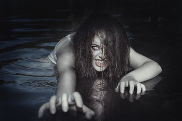 Young beautiful drowned ghost woman in the water