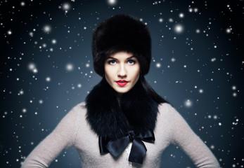 Fashion style portrait of a woman in an elegant winter fury clot