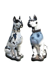 Garden statue of two dogs isolated over white