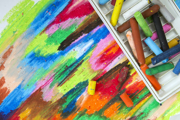colorful oil pastels crayons on drawing background