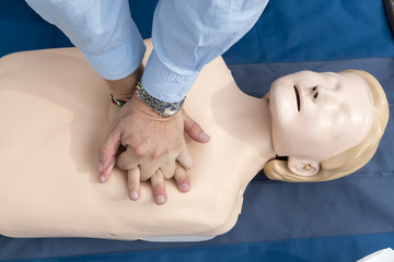 man instructor showing CPR on training doll