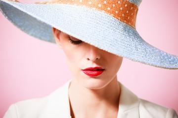 Woman wearing hat. Fashion studio portrait