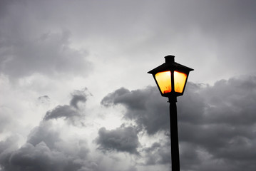street lamp against dark sky