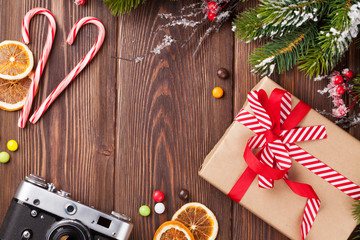 Christmas background with gift, camera and tree branch