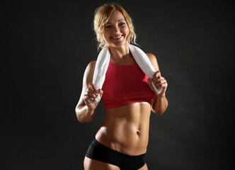 Athletic woman on dark background