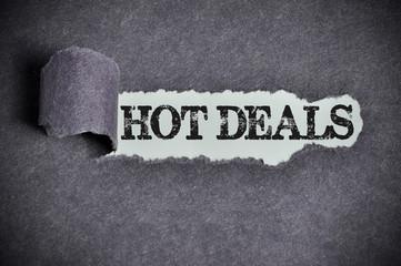 hot deals word under torn black sugar paper