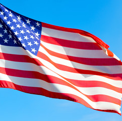 usa waving flag in the blue sky bcolour and wave