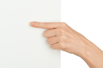 Humans hand with pointer finger holding blank card