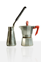 Two coffeemakers stainless steel and aluminum, one for cooking on the fire second geyser type