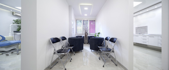 Modern waiting room in dental clinic-seamless panorama made with tilt-shift lens