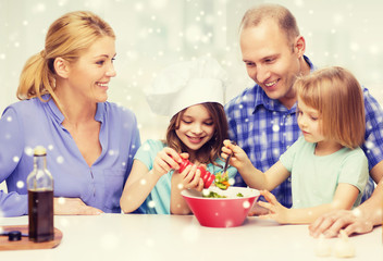 happy family with two kids making salad at home