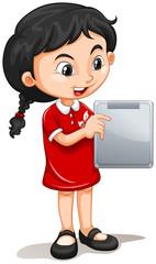 Little girl holding tablet computer