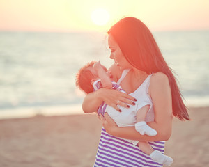 happy parents with baby on the beach
