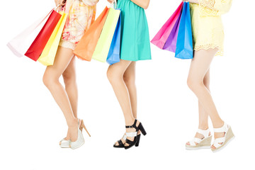 young Women with high heels and shopping bags