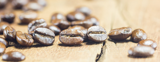 Coffee Beans  texture  on the wood background,selective focus,wo