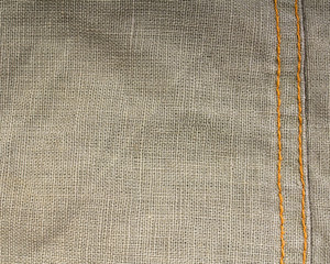 close up of texture of fabric with stitching