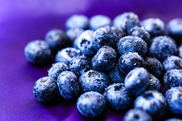 Blueberries close-up On purple background