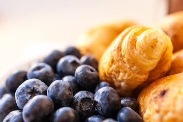 Blueberries with croissants close up