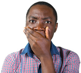 Handsome black man covering mouth with hand