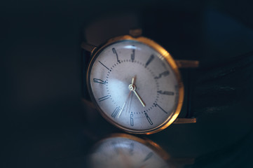 Vintage golden wrist watch. Old picture style