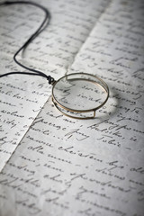 Old monocle on old original handwritten Polish letter