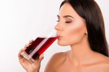 sexy healthy young woman drinking  cherry juice