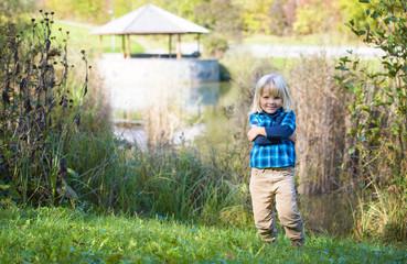 Smiling  little boy  posing in the beauty park