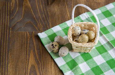 basket filled with eggs of quails at rug