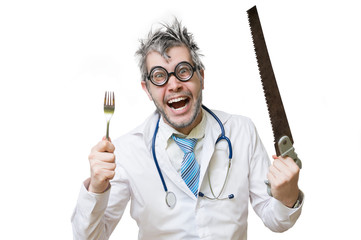 Funny and crazy doctor is laughing and holds saw in hand on whit
