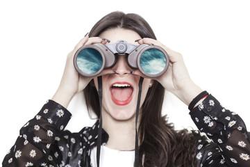 Girl portrait looking at cloudscape through binoculars