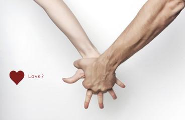 Man hand grasping woman hand, love?