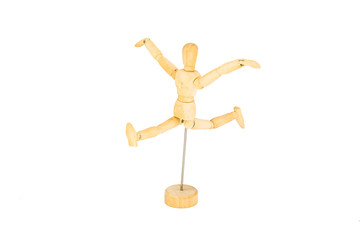 The wooden mannequin jumps with the hands lifted upwards isolate