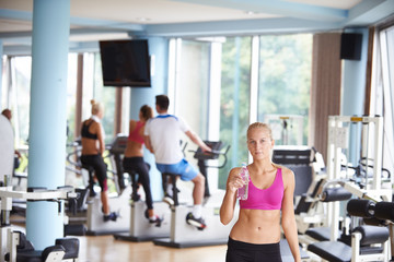 woman in fitness gym drink water