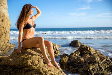 Perfect figure toned thin athletic body shape physique model bikini girl woman abs waist muscular looking out