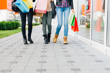 Three girls walking with shopping bags