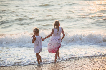 Two little girls on the beach