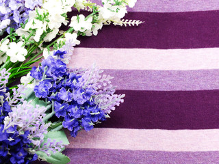 arrangement of artificial lavender flowers bouquet on fabric background