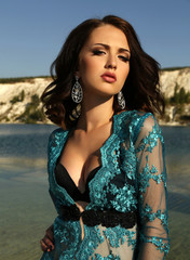 beautiful woman with short dark hair wears luxurious lace robe