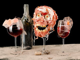 Halloween wine with prosciutto skull