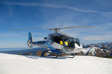 The helicopter landed on the mountain on the Khamar-Daban.