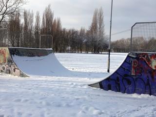 snow covered skateboard ramp, extreme sport