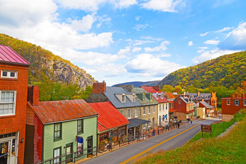 Harpers Ferry historic town in autumn and Blue Ridge Mountains. Houses on the street of historic town in Harpers Ferry National Historical Park, West Virginia, USA.