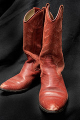 Red Leather Cowboy or Cowgirl Boots on a Black Background